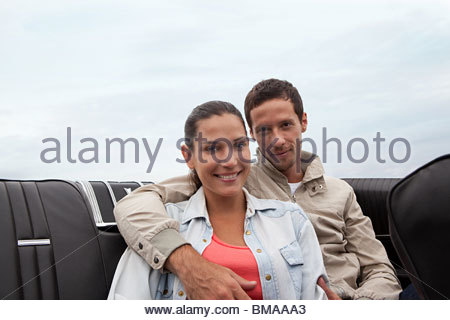 Young couple in convertible car - Stock Photo
