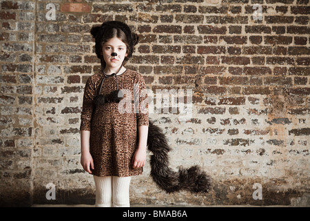 Young girl dressed up as cat - Stock Photo