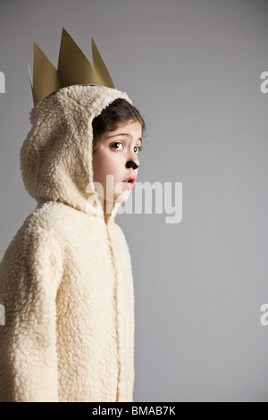 Young girl dressed up as sheep, wearing gold crown - Stock Photo
