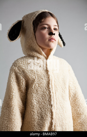 Young girl dressed up as sheep - Stock Photo