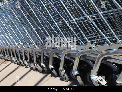 Stacked shopping trolleys from a supermarket, Scotland - Stock Photo