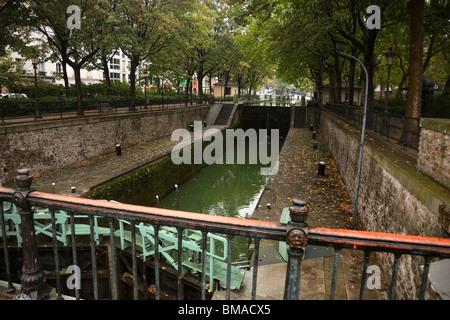 Quai de Valmy Canal and Locks, Paris, Ile-de-France, France - Stock Photo