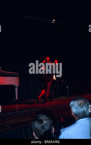Professional tango dancers performing in a tango show. - Stock Photo
