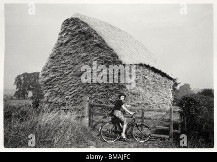 Archive Photo: Cycling woman by haystack (c1945) - Stock Photo