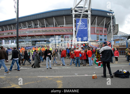 Crowd in front of Millennium Stadium before a rugby match, Cardiff, UK - Stock Photo