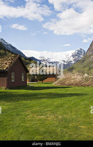Wooden Holiday Cabins in Campground in Boyum Fjaerland with Skeisnipa Mountain and Vetlebreen Glacier and Almenipa - Stock Photo