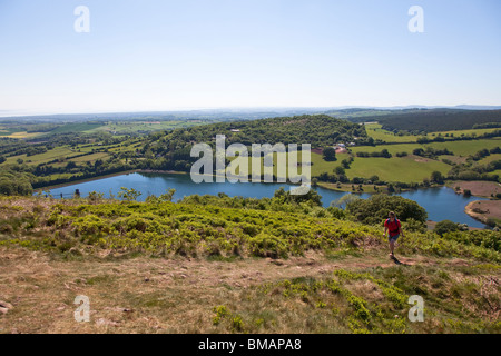 Walking up Gray Hill or Mynydd Llwd onto common land with Wentwood reservoir in background Caerwent Gwent Wales - Stock Photo