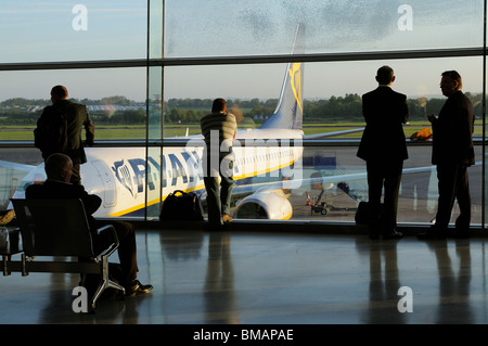 Dublin International Airport.  Terminal interior with passengers waiting to board a 'redeye' early morning flight - Stock Photo