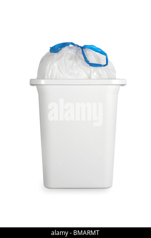 A white trash can with a full plastic garbage bag tied with a blue draw band. - Stock Photo