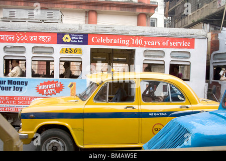Tram and taxi traffic on road of Calcutta now Kolkata ; West Bengal ; India - Stock Photo