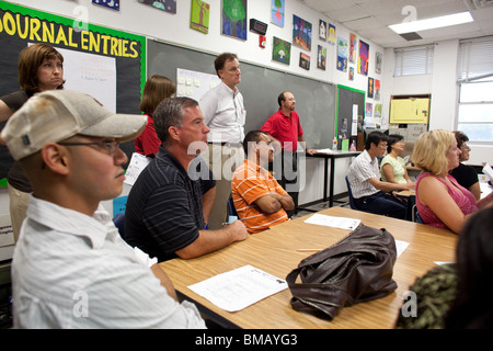 Parents of middle school students listen to a teacher during back-to-school night at Kealing Middle School in Austin, - Stock Photo