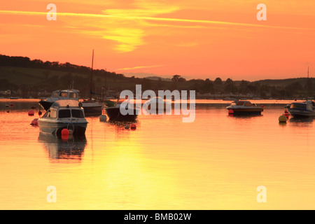 Sunset over Exe Estuary view towards Starcross from Exmouth, East Devon, England, UK - Stock Photo