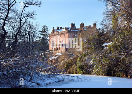 Sorn Castle with the River Ayr frozen over in winter 2010. The castle dates from the 14th Century. - Stock Photo