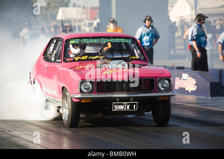 Supercharged Holden Torana drag racing car performing a burnout prior to racing at the Perth Motorplex, Western - Stock Photo