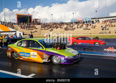 Australian drag racer, Maurice Brennan (closest to camera), lines up for a race at the Perth Motorplex, Western - Stock Photo