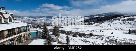 Panoramic winter scenic view of snowy Rocky Mountains in Vail Colorado, USA from luxury resort - Stock Photo