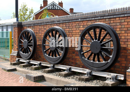 Old steam locomotive wheels by railway station, Kirkby in Ashfield, Nottinghamshire, England, UK - Stock Photo