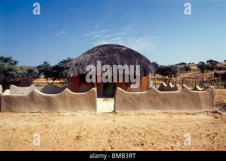 Traditional decorated mud huts - Stock Photo