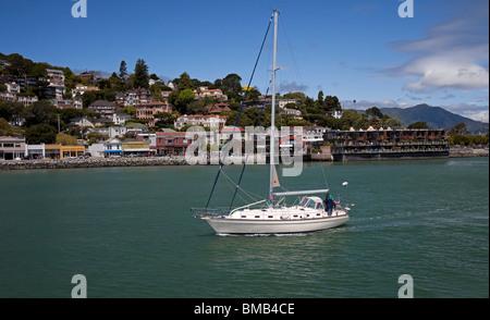Sailing yacht with waterfront of Sausalito, California USA - Stock Photo