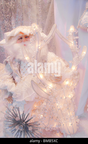 Santa Claus figure in 'Wind in the Willows-Beth Boutique' shop window, Naples, Florida, USA - Stock Photo