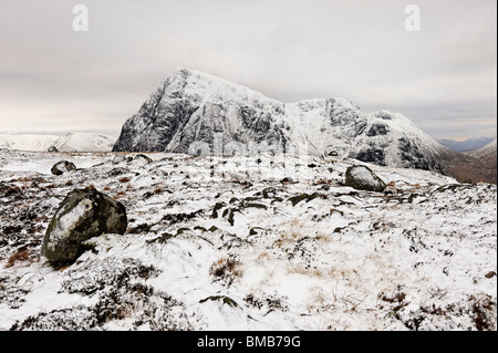 High on Scottish mountains, in hard winter conditions. This is a view of Buachaille Etive Mor from Beinn a Chrulaiste. - Stock Photo
