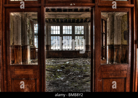 Abandoned Activity or Day Room in a Derelict Lunatic Asylum. - Stock Photo
