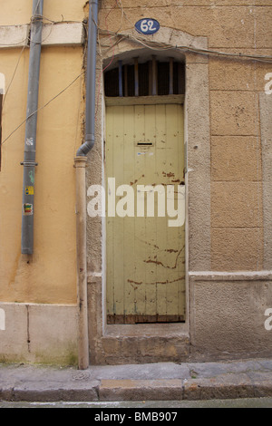 old French doorway in Marseille, house number 62 - Stock Photo