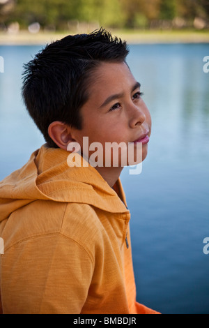 9-11 year old Hispanic American boy outside contemplating life. thoughtful dreaming thinking sitting MR  © Myrleen - Stock Photo