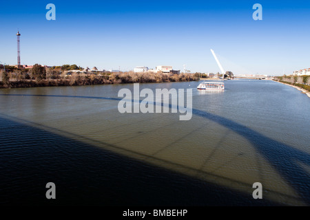 Guadalquivir river from Barqueta bridge, which casts its shadow on the water, Seville, Spain - Stock Photo