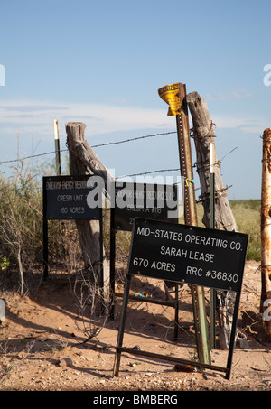 Oil operating lease signs on land at Midland Texas USA - Stock Photo