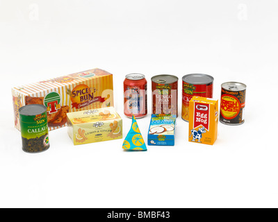 Selection Of Packets Of Caribbean Food In Shapes Of Prisms, Triangular, Cylindrical And Cuboid - Stock Photo