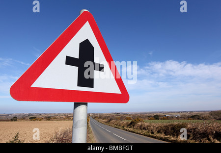 British crossroads ahead road sign warning. - Stock Photo