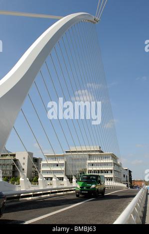 Samuel Beckett Bridge Docklands Dublin Ireland A green post office vehicle passing over - Stock Photo