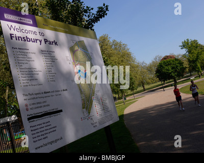 finsbury park gardens and local park with joggers and sign, north London - Stock Photo