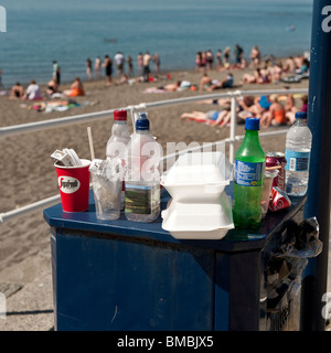 Overflowing rubbish bins on Aberystwyth promenade at the end of a hot summer day, Ceredigion, Wales, UK, - Stock Photo