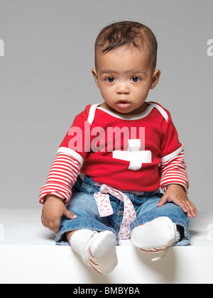 Portrait of a cute little child. Nine months old baby girl. - Stock Photo