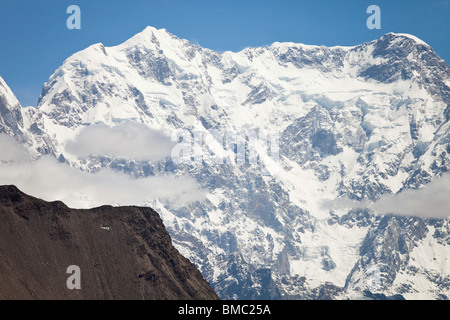 The Ultar Massif with helicopter in foreground, Hunza, Pakistan - Stock Photo