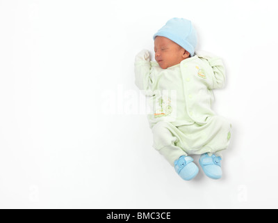 Newborn child baby boy asleep isolated on white background - Stock Photo