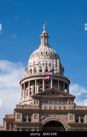 Dome of Texas state capitol building or statehouse in Austin with Texas and United States flags - Stock Photo