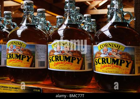 flagons of cornish scrumpy cider in a farm shop near truro,cornwall,uk - Stock Photo