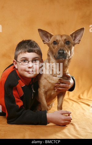 Junge schmust mit Hund / boy with dog - Stock Photo