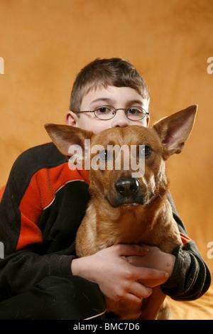Junge schmust mit Hund / boy with dog - Stock Photo
