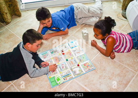 "Young girls playing the African board game ""owari"" in ..."