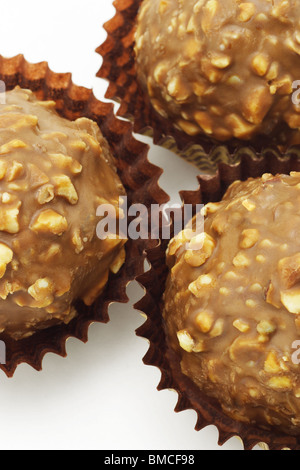 Close up view of chocolate with nuts balls in paper cups - Stock Photo