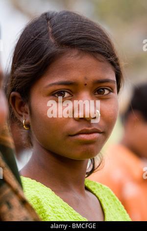 Closeup Portrait of attractive young ethnic female dark penetrating eyes dark skin dark hair facing profile pose - Stock Photo