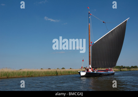 Historic Norfolk trading wherry Albion on the River Bure, Broads National Park - Stock Photo