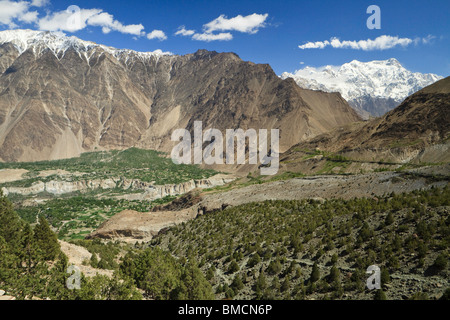 The view down towards the Hunza River from high above Minapin, Hunza, Pakistan - Stock Photo