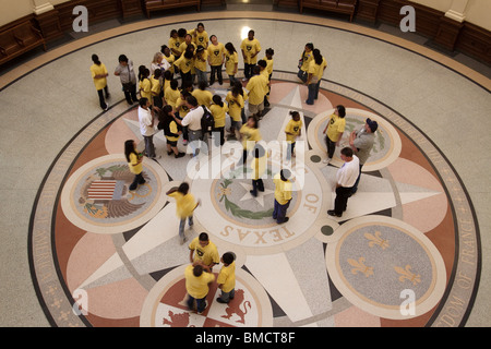 School children on guided tour of Texas state capitol building rotunda in Austin - Stock Photo