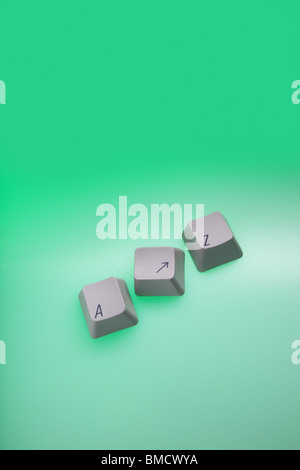 Three separate computer keys, A, arrow and Z, on a graduated green background. - Stock Photo