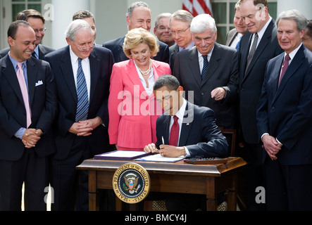 President Barack Obama Signs the Credit Card Accountability Responsibility and Disclosure act. - Stock Photo